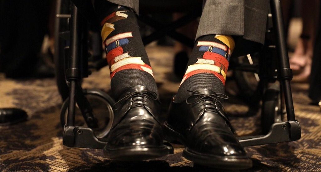 Former President George H. W. Bush wore socks with a book design to honor his wife, Barbara, during her funeral.